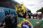 AP: Demonstrators carrying placards protesting against the forthcoming World Cup attacked a bus carrying the Brazilian national football team today.